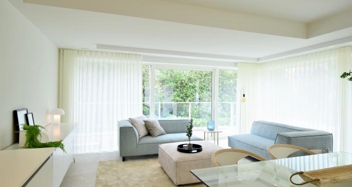 miami style, chique interieur, blauwe loungezetel, luxe interieur, hyboma, koksijde, villa